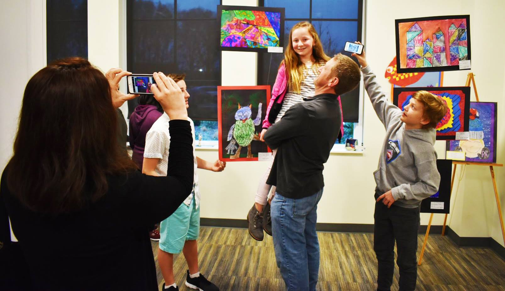 A family enjoys their young student artist's work last year at the Indian Trail Town Hall.