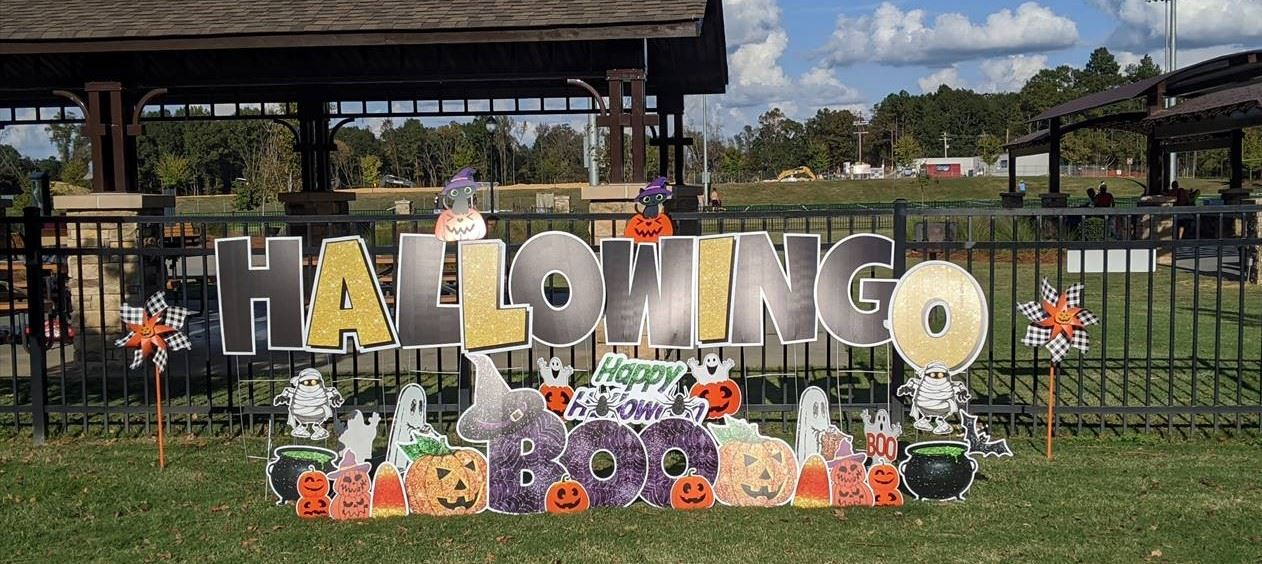 HalloWINGO sign surrounded by Halloween decorations